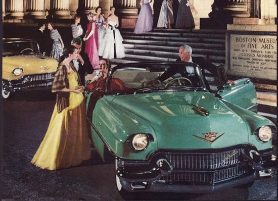 Beautiful color photo of two 1956 Caddies pulled up in front of the Boston Museum of Fine Arts.