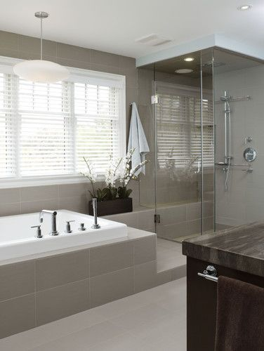 master bathroom contemporary bathroom- seamless heavy glass shower surround with brushed nickel hardware, modern large rectangular floor and wall tile, modern pendant light hanging over bathtub