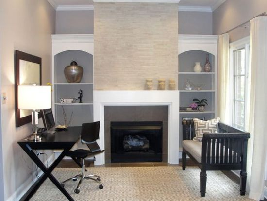 Clean, calm, minimalist in a small space- with desk facing window.