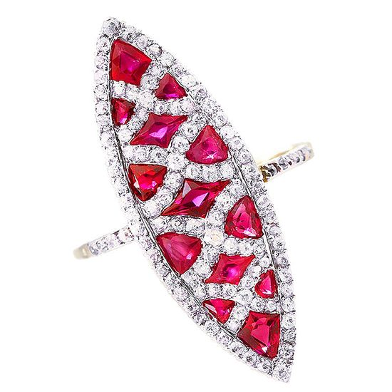 ? France  20th Century  Ravishing elongated marquise shaped platinum and 18k yellow gold fashion ring. 13 calibrated rubies in various shapes make up the the filling while diamond pave criss-crosses the length and edges.    The color on these rubies are one of a kind ?