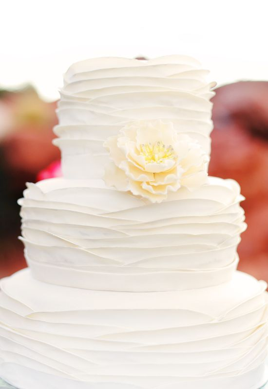 White wedding cake by Bianca's Designer Cakes. Like this idea but with a pink flower to make it pop.