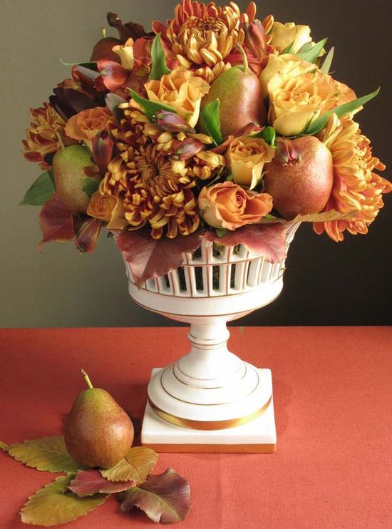 Fall arrangement using mums and pears.