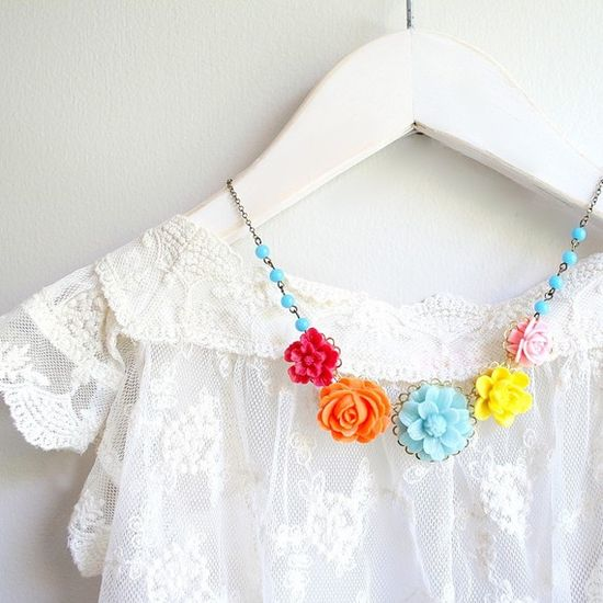 Apparently the jewelry is from Etsy (according to the poster before me). I love the colors against the white dress/shirt.