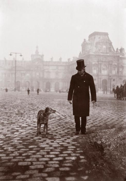 Painter Gustave Caillebotte and his dog in front of the Louvre, 1876