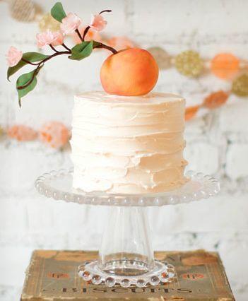 Cream + peach wedding cake