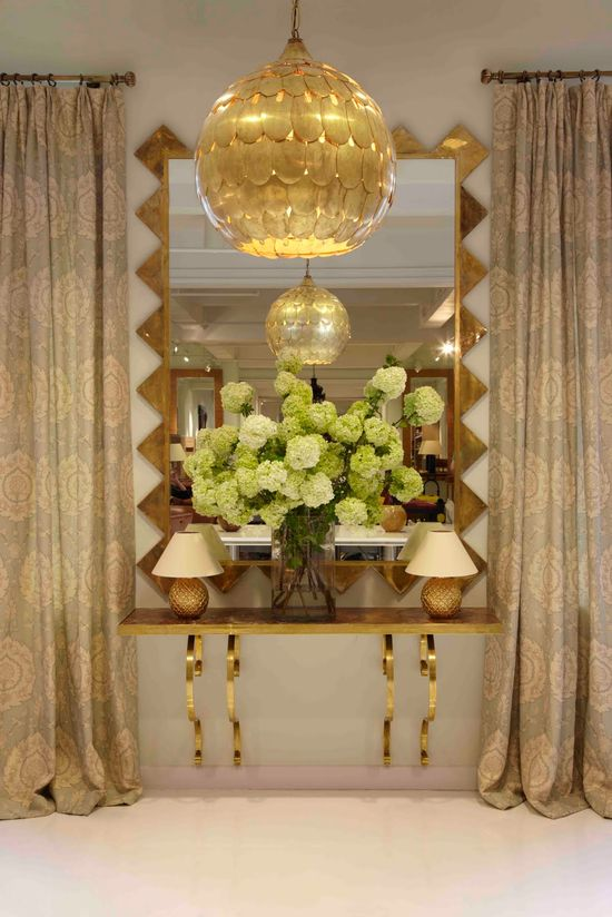 dramatic chandelier, unique mirror + consol table design
