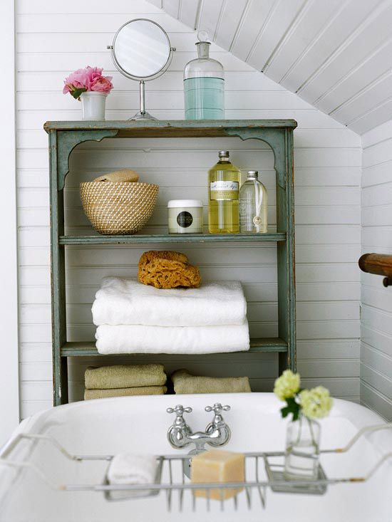 Low cost bathroom update: bring in furniture to add utility and character. An old shelving unit updated with paint provides a bath-side perch for towels, soaps, and accessories. #DIY #Decorating