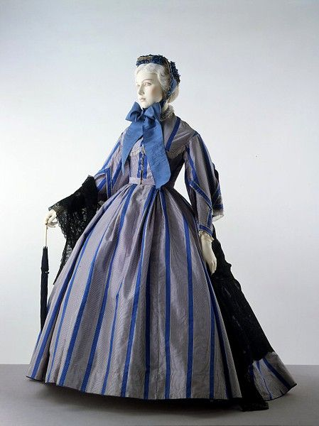 """Dress  Place of origin: United Kingdom (made)  Date: ca. 1866 (made)  Artist/Maker: Unknown (production)  Materials and Techniques: Silk, trimmed with bugle beads and silk fringe, lined with cotton, reinforced with whalebone, machine and hand sewn"""