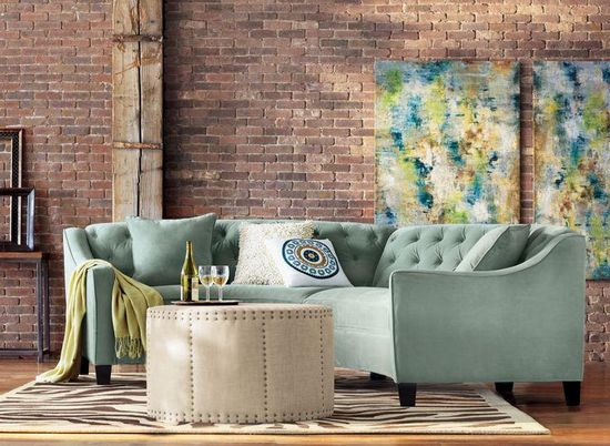 Complete your living room design with a curved tufted sectional