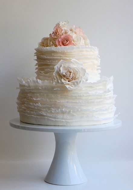 This ruffled cake is so delicate!  I'm not wild about the flowers though...