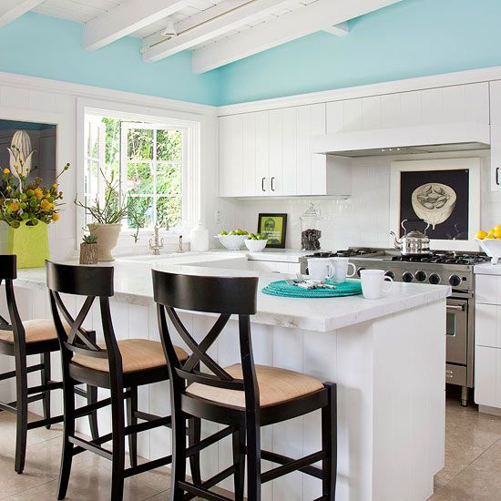 A touch of light blue paint adds cheer to this cute kitchen. See more ideas for small kitchens: www.bhg.com/...