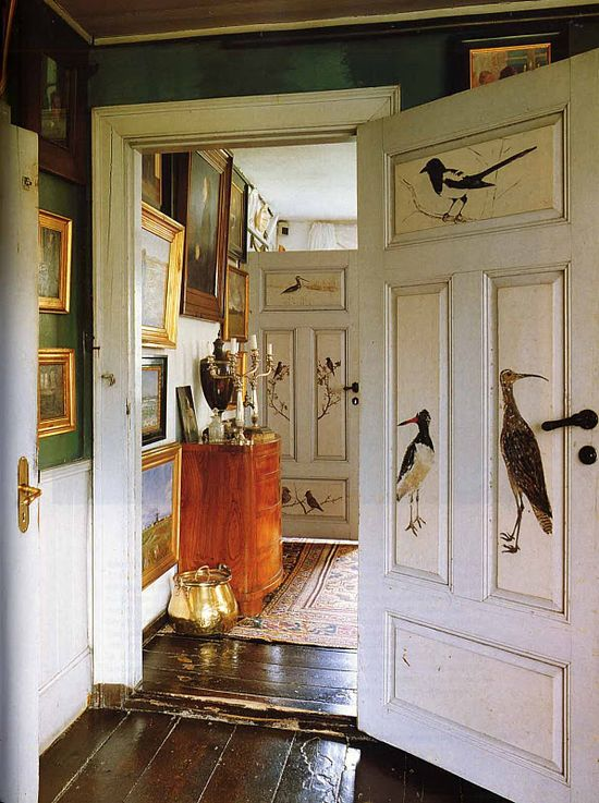 "Raised-panel doors painted with bird portraits in the early 20th century by  Michael Ancher. Photo by Andreas von Einsiedel for ""The World of Interiors"""