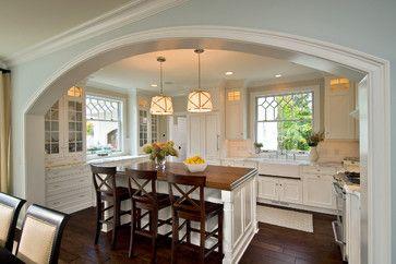 White cabinets / dark wood floor