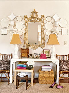 pair of chinoiserie mirrors over pair of white console tables