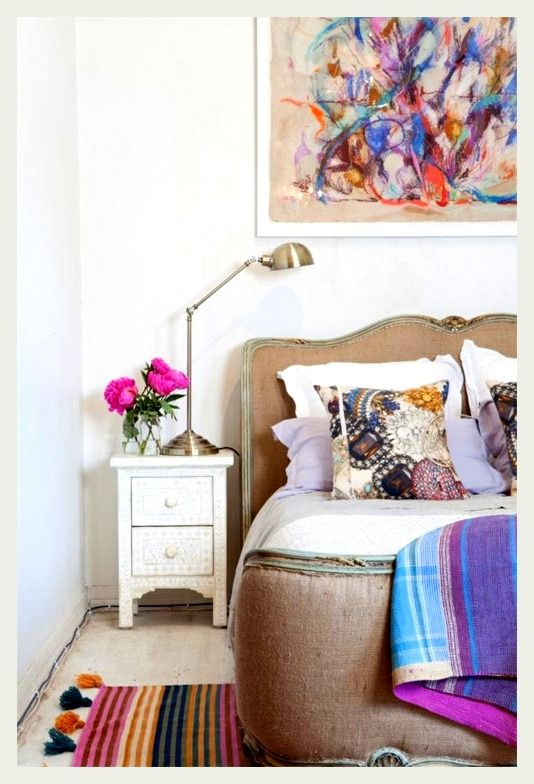 colorful bedroom with abstract art