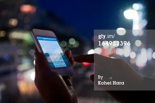 High-Res Stock Photography: a woman using a smart phone