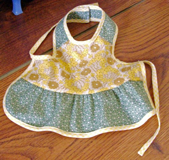 Depression Era 1930s Style Cotton Reproduction Print Fabric Apron for American Girl Dolls or Other 18 Inch Friends. $10.00, via Etsy.