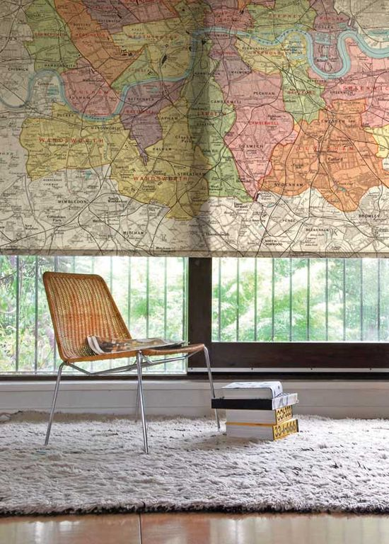 Love. this. idea. pull down map in front of window. saves space on the wall & acts as a window shade.