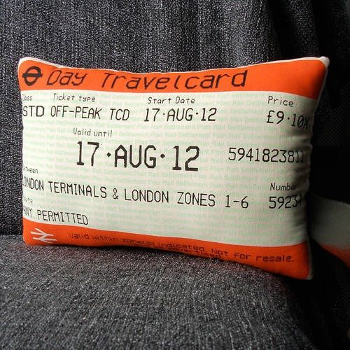 BEST IDEA EVER: take a ticket stub, plane ticket or whatever to kinkos, have them blow it up, print it on that fabric transfer material to make a pillow.