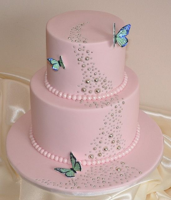 Little girl's pink birthday cake, thinking of Ara's fourth b day. This needs a lot more butterflies for her to love it!
