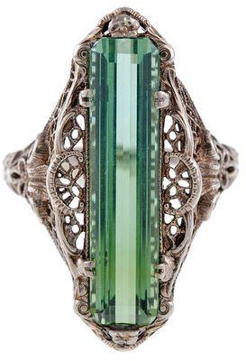 Antique green tourmaline filigree ring, circa 1880. Via Diamonds in the Library. Via Diamonds in the