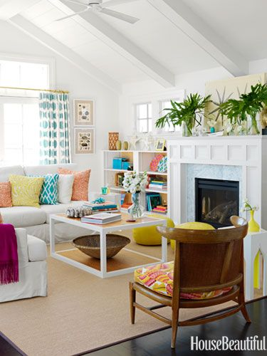 A family room with colorful accents. Design: Mona Ross Berman. Photo: Jonny Valiant. housebeautiful.com. #yellow #family_room #beach_house #poufs #moroccan_poufs #throw_pillows