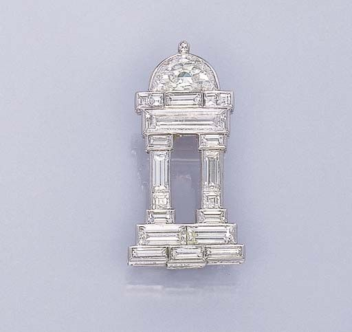A DELICATE DIAMOND TEMPLE BROOCH, BY CARTIER   With baguette-cut diamond columns and base to the half-moon dome, circa 1928, with French assay mark  Signed Cartier, no. 02647