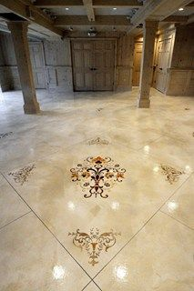 Decorative concrete at it's finest.  This concrete floor features a concrete overlay with stenciling and concrete staining techniques.  Custom Concrete Solutions, LLC West Hartford, CT