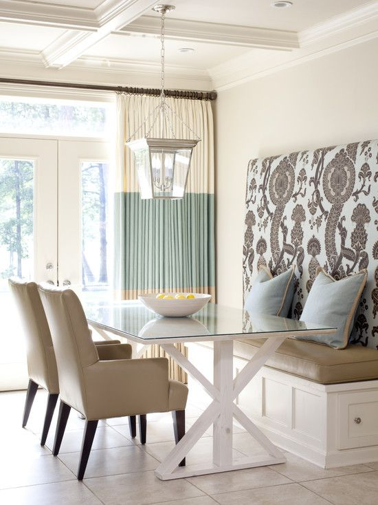 Love the Drapes with the Large band of tiffany-esk blue.  Love the high back upholstered bench with storage.  The two chairs look like they're upholstered in an easy to keep clean vinyl.  The Ceiling detail is beautiful.  I also love the light fixture over the table.