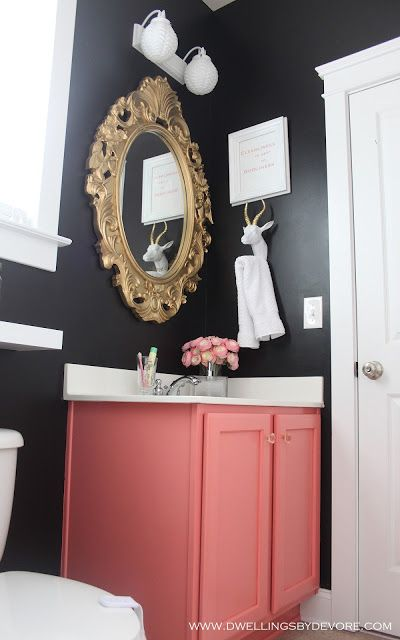 Coral Vanity. Black Walls. Gold and White Accents. Bathroom.