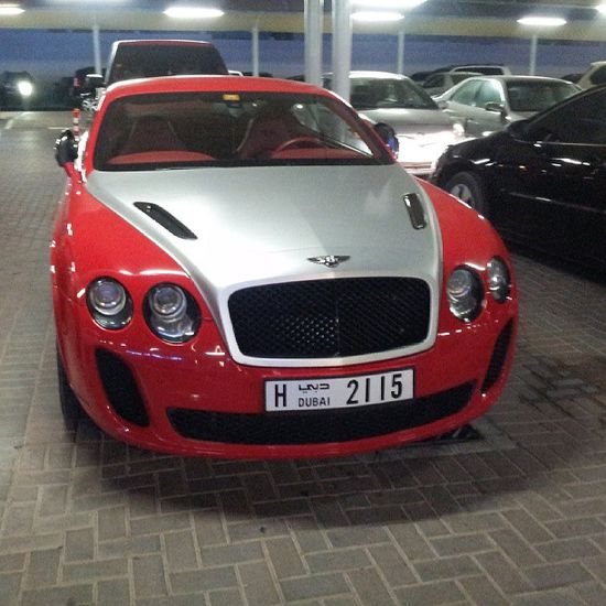 Red Bentley Continental GT with a sexy silver bonnet!