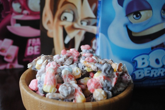 Halloween Trash Candy- festive Halloween cereal mixed with m-and-m candies and candy corn all coated in white chocolate. Easy and delicious! @shugarysweets