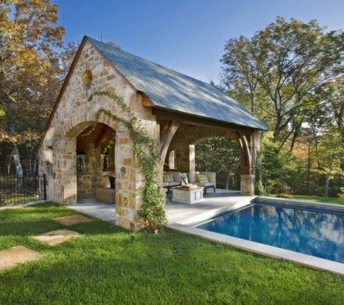 Like this pool connected to the covered patio with maybe a bar, seating, and TV...