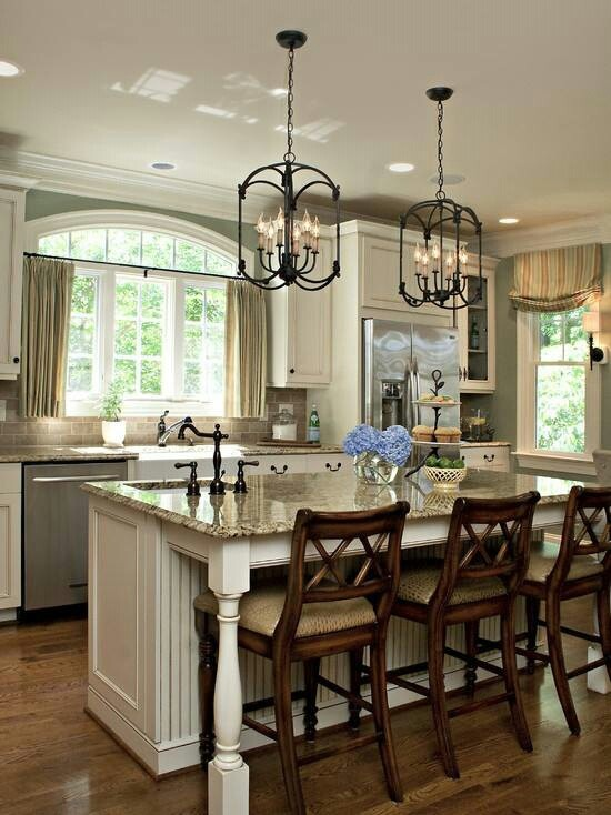 Elegant- light fixtures, stools and countertops.