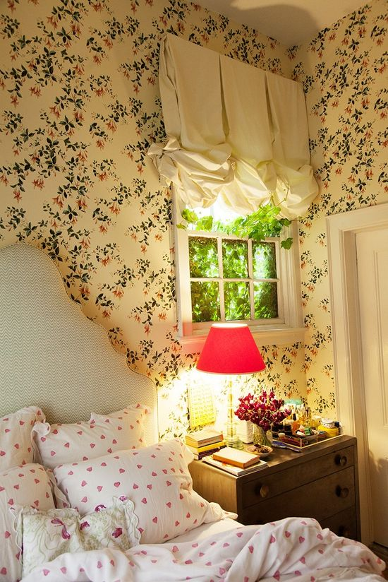 pretty bedroom....love the wallpaper, perfect for a small room..
