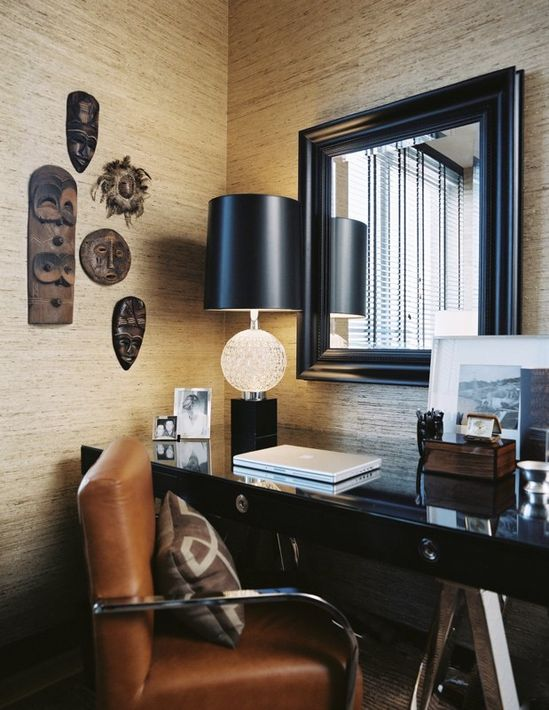 Very Chic Home Office with rich deep colors & collections from their world travels.