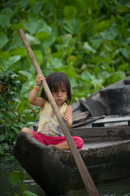 Vietnamese Girl on Tonle Sap Lake by Paul Cowell