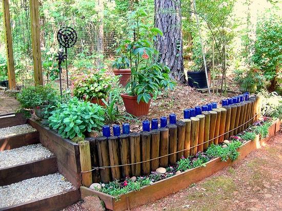 Blue bottle folk art garden wall