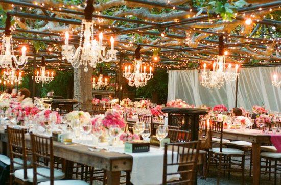 pink wedding reception table outdoor chandeliers