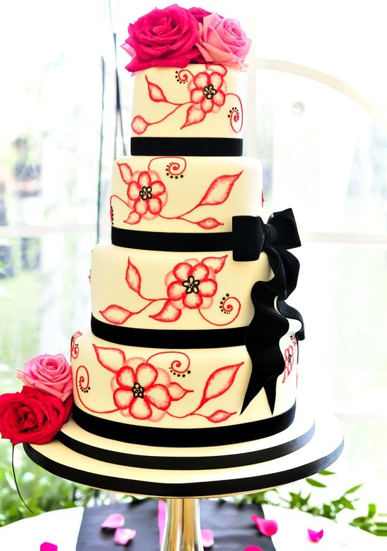 Painted pink wedding cake with pink roses. #Bow #Black #Ivory #White.  #Flowers #Floral. @Celebstylewed