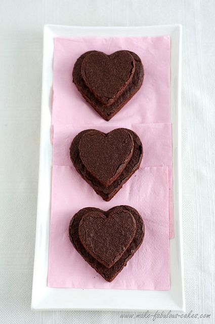 Sweetly lovely heart shaped brownies for Valentine's Day or anytime you want to celebrate love. #hearts #brownies #chocolate #food #love #dessert #baking #Valentines #Day