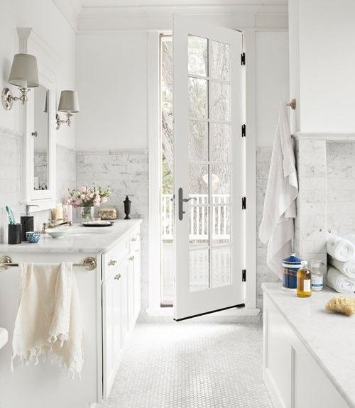 White bathroom, marble countertop sink