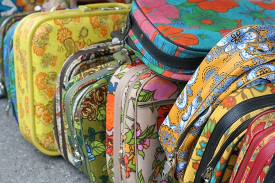 1970's suitcases -- I had a sleeping bag in a similar pink flowered pattern too.