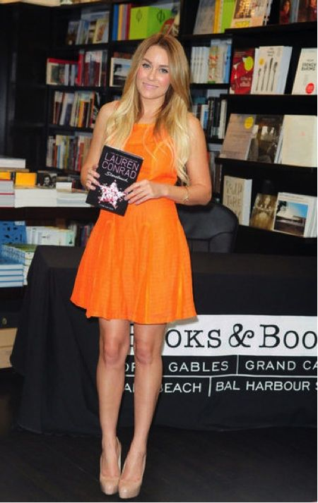 Lauren Conrad wearing an orange dress at a Book Signing in Florida