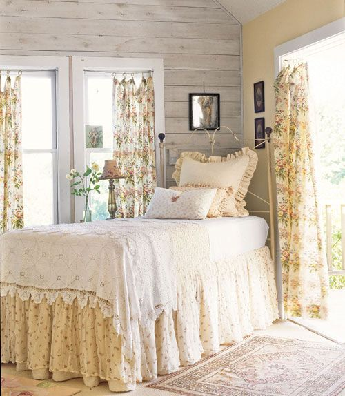 """Victorian floral style bedding in airy bedroom: """"Layered linens make a bed as graceful as a Victorian dress, starting with an """"underslip"""" of matelasse and moving on u to a chenille blanket and white lace throw. A pastel palette keeps things relaxed."""""""