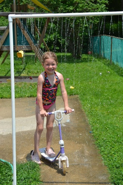 PVC pipe water sprinkler. Cool off in the summer time. Looks really easy to do and fun for the kid.