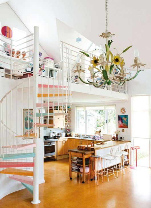 A happy kitsch loft. love the staircase!