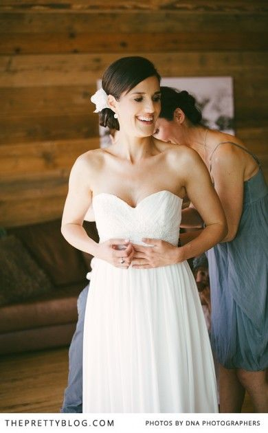 Off-shoulder white wedding gown & flower hair accessory