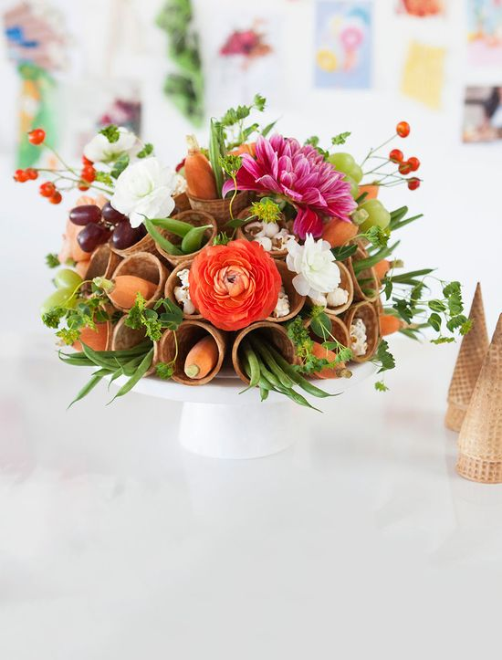 Use ice cream cones to make a modern cone-a-copia filled with flowers, fruit, veggies, and even popcorn!