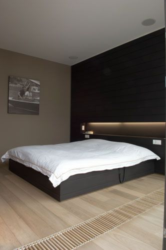 :: BEDROOMS :: Image Credit: Ensemble et Associes. Project: De Brouckère. Lovely master bedroom feature wall. Dark bold and simple niche detail #bedrooms
